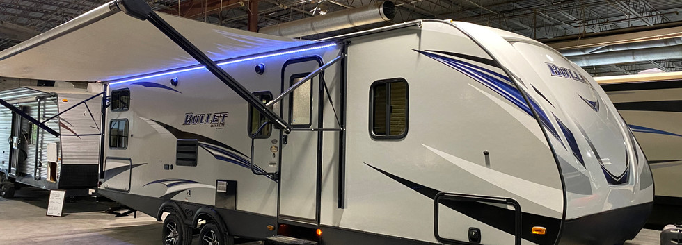 2019 Keystone Bullet. Model number is 277BHS. Thermal package!!  Camper is 27ft long. Dry weight is 5600 pounds.  Has one slideout. Electric awning and manual jacks. Small outside kitchen.  Outside is in very good condition.  Has bunk beds!! Living room and kitchen is spacious. Dinnette and couch fold into beds. Queen size bed up front!  Does have a rebuilt title from hail damage! Priced at $ SOLD