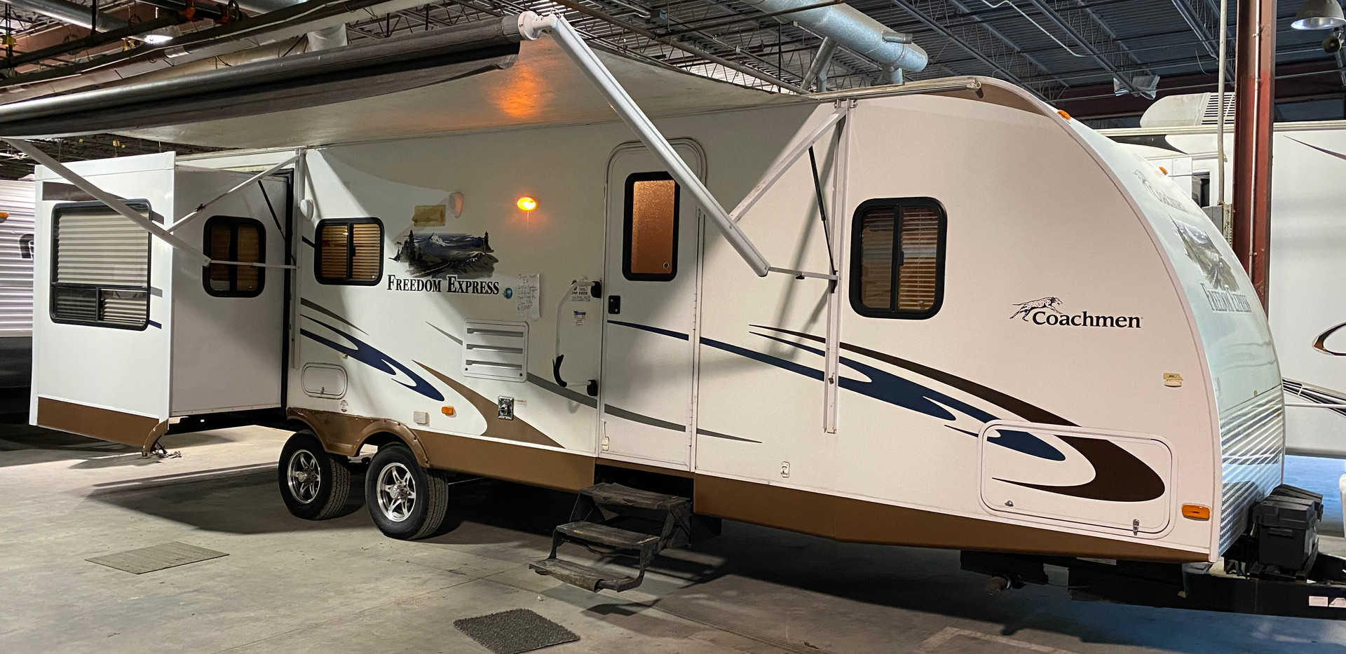 2012 Coachmen Freedom Express. Model number is 296REDS. It is 29ft long.  Dry weight is 6,800lbs. Does have two slideouts. Electric awning and electric jacks.  Very nice inside and out!!  Inside opens up to a very spacious open floor plan. Tv slides down into the cabinet. Nice size bathroom with walk in shower. Queen bedroom up front!  Does have a CLEAN TITLE!  Asking $15,800.
