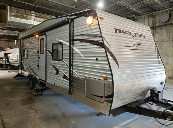 2014 Gulfstreams Track and Trail TOYHAULER. Model number is 24RTH. Camper is 24 feet long. Dry weight is 5600 pounds. Has a manual awning and manual jacks. Inside is very nice. Drop down bed and couches makes a bed also. Cargo area is 94 inches deep to the refrigerator, 73 inches wide with couches folded up. 90 inches wide if you was to take the couches completely out, and 86 inches tall. Everything works as it should in the kitchen. Queen size bed up front. Bathroom has a stand up shower as well. Very nice little toy hauler! Does have a clean title but has some hail dings on it. Priced at $16,500.