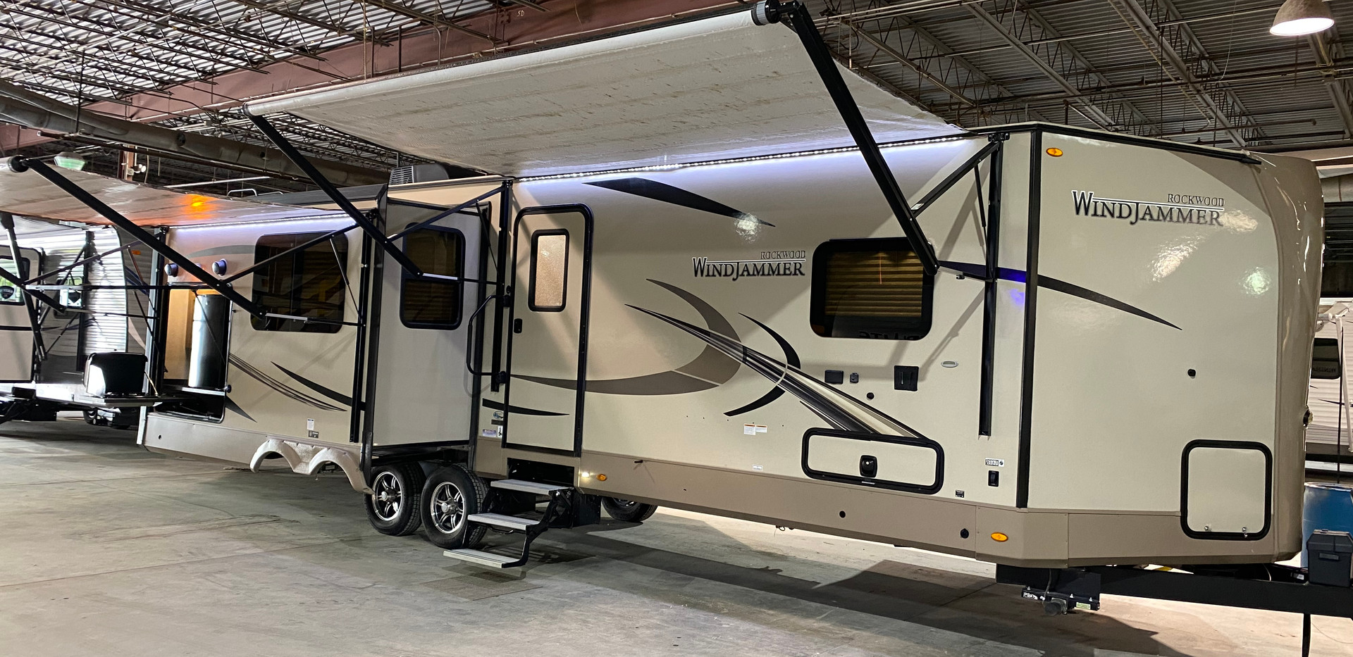 2019 Forest River Rockwood Windjammer. Model number is 3029V. Camper is 30 feet long. Dry weight is 8200 pounds. Has three slideouts. Two electric awnings, and electric stabilizer jacks as well! Outside kitchen with a grille and mini fridge. Inside is a beautiful open layout! L shaped countertop. A fireplace and big TV. Couches are messaging and heated! Bedroom has a King size bed in it and has a closet up front. Bedroom has a stand up shower. Camper has a Clean title! Priced at $26,500.