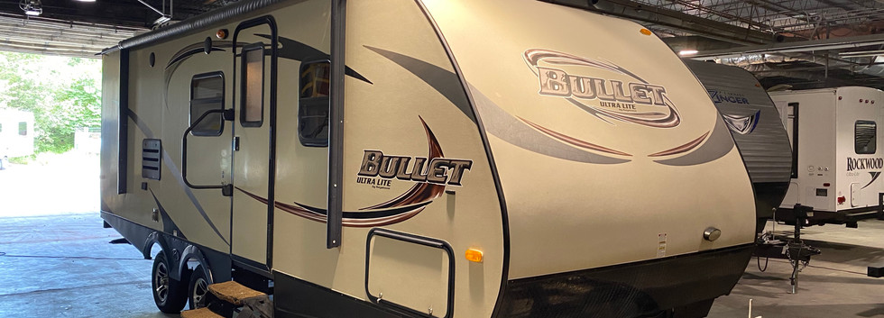 2014 Keystone Bullet Ultra-lite. Very nice camper. Model number is 230BHS. 27ft long. 1 slideout, dry weight is 4400 pounds.  Does have an electric awning.  Inside is very clean. Does have bunk beds in the corner. Dinette and folds into a bed. Stand up shower. Does have a rebuilt title. Priced at $14,500