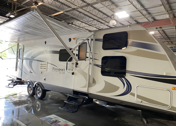 2013 Keystone Passport Ultralite Elite. Model number is 32FB. Camper is 32 feet long. Dry weight is 6500 pounds. Has two slideouts. Electric awning with a brand new canvas. Has manual jacks. Inside is very nice for the year. In the very front there is double bunkbeds. Rear has a private bedroom with a slideout. Queen size bed. Living room and kitchen is in the middle. Couch folds out to bed. Everything works as it should. Sleeps 7-9 comfortably. Does have a rebuilt title from hail. Vents on the roof was busted and the diamond plate on the front still has some dents. Priced at $17,000