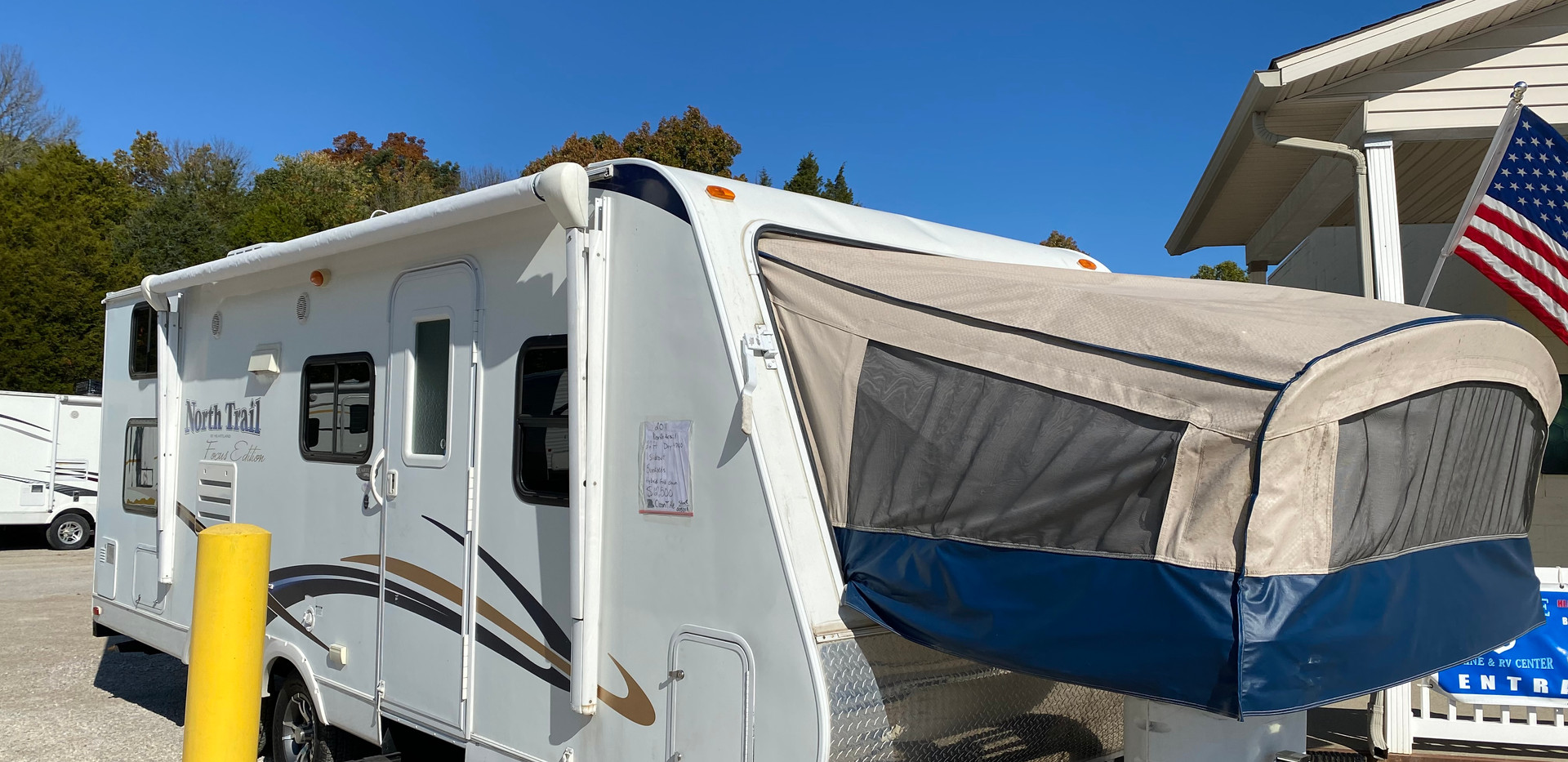 2012 Heartland North Trail. Model number is T-22. Camper is 22 feet long, dry weight is 4700 pounds. Has electric awning, canvas is brand new, and manual jacks. Has one slideout and one hybrid fold down end. Inside is in good condition. Has bunk beds in the back. Living room and kitchen in the middle. Couch and dinnette both fold into beds. And then had the hybrid fold down bed in the very front. Canvas is in good shape no holes or tears. Does have a rebuilt title. Priced at $11,500