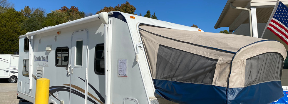 2012 Heartland North Trail. Model number is T-22. Camper is 22 feet long, dry weight is 4700 pounds. Has electric awning, canvas is brand new, and manual jacks. Has one slideout and one hybrid fold down end. Inside is in good condition. Has bunk beds in the back. Living room and kitchen in the middle. Couch and dinnette both fold into beds. And then had the hybrid fold down bed in the very front. Canvas is in good shape no holes or tears. Does have a rebuilt title. Priced at $12,500