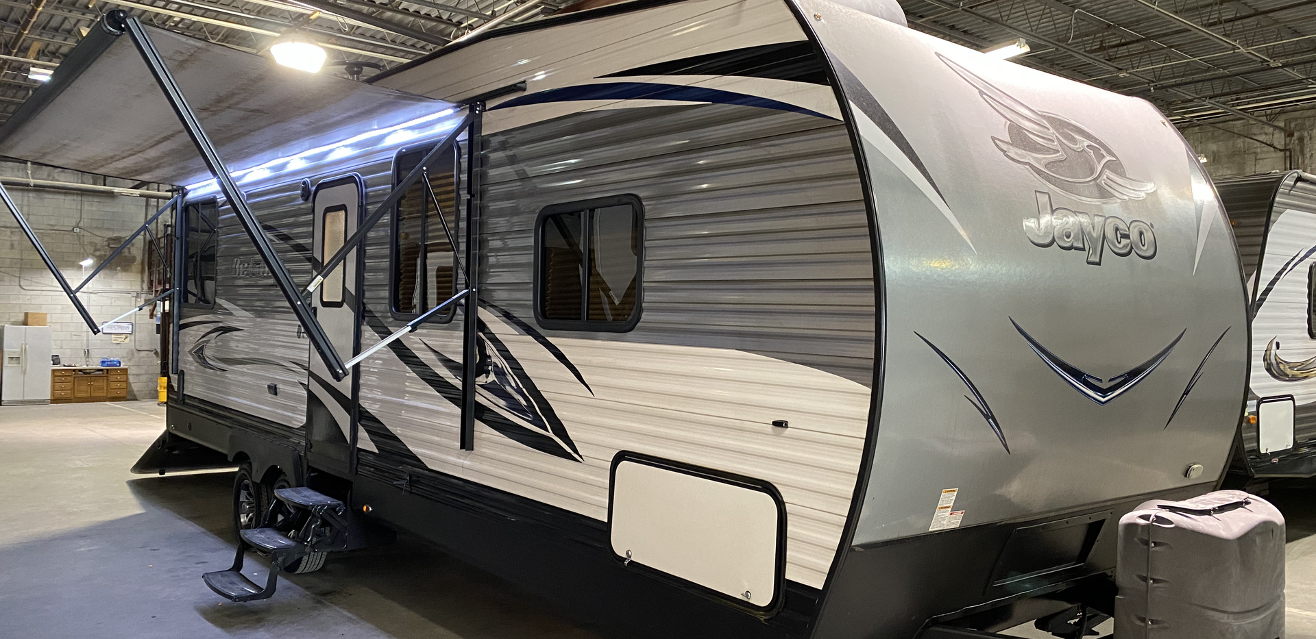 2018 Jayco Octane Toyhauler!! Model number is 273. The camper is 27 feet long. Dry weight is 6900 pounds. Has a big electric awning and manual jacks. Does have a fuel station. Back door is 93 inches wide. 78 inches tall and it is 12 feet to the front of the fridge, and 8 feet to the counter. It is very nice inside and out! Bed drops down in the back to make two beds. Up front is a private bedroom with full bathroom. Super nice camper inside and out. Drop down screen when the door is down. Rear flood lights. Camper does have a rebuilt title from hail.. Very light dings. Priced at $17800.
