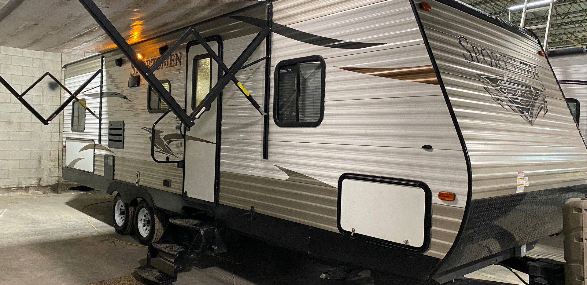 2016 KZ Sportsmen. The model number is 280. Camper is 28 feet long. Dry weight is 5500 pounds. Does have one slideout. Electric awning. Inside is very nice. Has bunkbeds in the rear. they are full size bunkbeds! Kitchen and living room is in the middle. Dinette and couch fold down into beds. Bedroom is up front. Sleeps 6-10. Does have a rebuilt title from tree limb damage to the very front. Priced at $14,500.