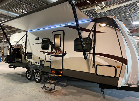 2015 Keystone Sprinter. Model number is 266RBS. Camper is 26 feet long. Dry weight is 6700 pounds. Has one slideout. Electric Awning. Big outside kitchen with sink, fridge and grille. Aluminum wheels. Inside is a very nice open layout. Bathroom is in the back and is very big. Large corner shower. Living room and kitchen is in the middle. Queen size bed up front. Nice little camper. Does have a rebuilt title from the busted spot in the fiberglass on the very front. Doesn't effect anything. Priced at $19,000.