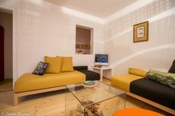 canapé-lit noir et beige