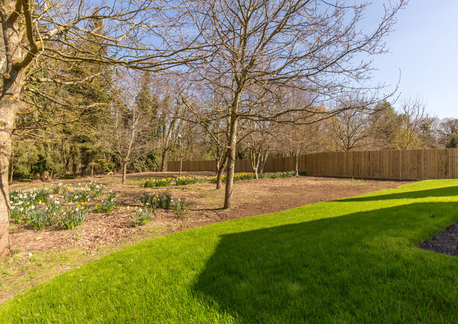 Tree lined garden of one Hidden Brookouse