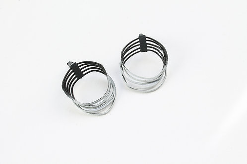 statement pair of loop earrings in a black and grey gradient with blackened silver clips