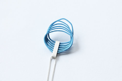 beautiful elegant sky blue loop pendant with a silver clip, hanging on a fine silver chain