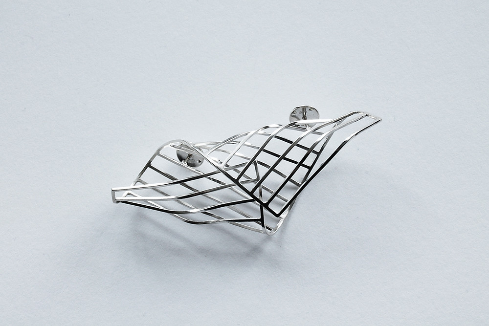 Polished silver folded wire Cocoon Brooch.