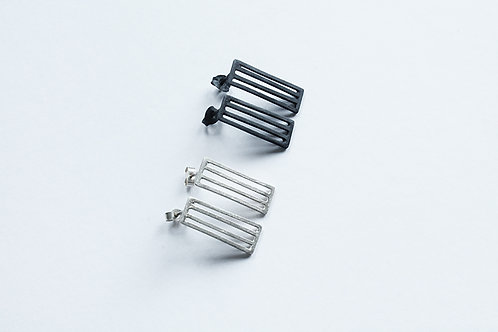 two pairs of contemporary handmade silver minimal rectangular grid earrings in a blackened and polished finish