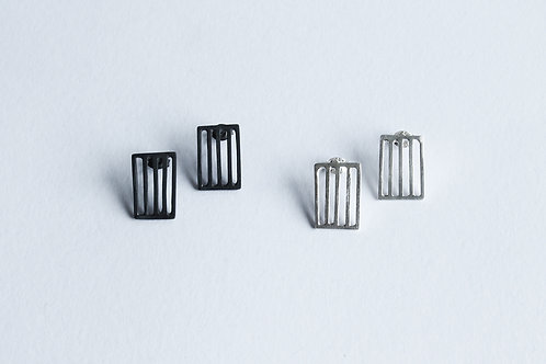 two pairs of contemporary silver minimal square grid earrings in a blackened and polished finish