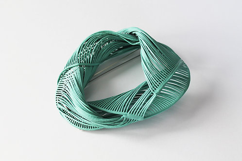 statement mint green brooch in a linear oval twisted shape