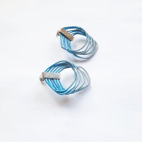 contemporary handmade seconds loop earrings in a blue and grey gradient with silver clips