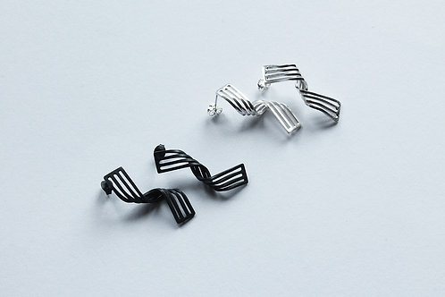 two pairs of contemporary handmade elegant twist earrings, one polished and one blackened silver