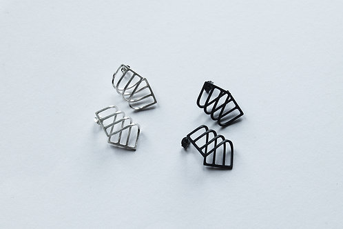 two pairs of curve linear earrings - one polished and one blackened silver