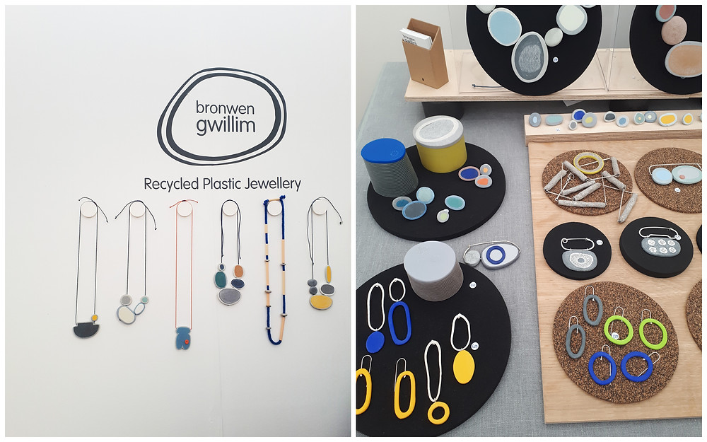 """Two photo of Browen Gwillim's stand at Craft Festival. Photo 1 features Bronwen's logo, text that says """"Recycled Plastic Jewellery"""", and a selection of 6 necklaces. Photo 2 is a close up of her table, with a range of colourful plastic jewellery."""