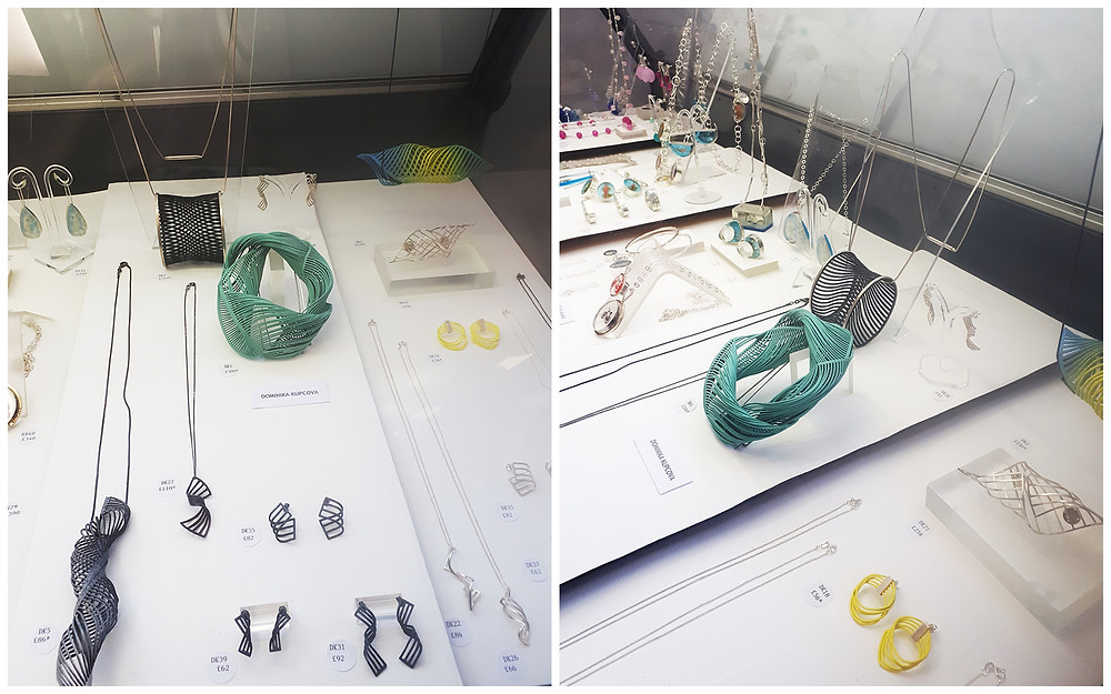 Two angles of Dominika Kupcova Jewellery display at Dazzle Edinburgh featuring a selection of jewellery, including statement colourful pieces, and smaller oxidised silver works.