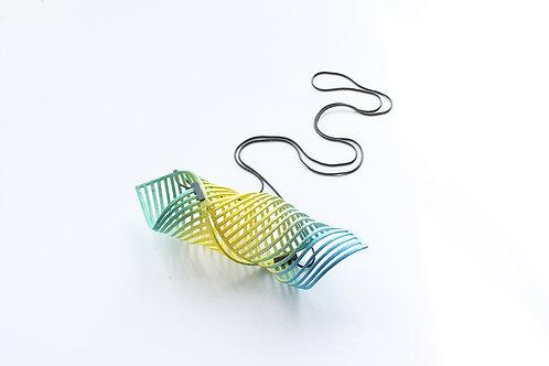 a sky blue, yellow and mint green statement pendant in a horizontal twist shape hanging on a black chain