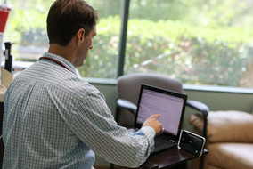 Erik Lundquist on Computer, Temecula Center for Integrative Medicine