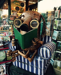 whimsical dog sculpture reading a book
