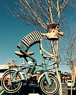 whimsical bicycle rider sculpture
