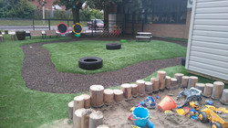Outdoor learning environment with sandbox