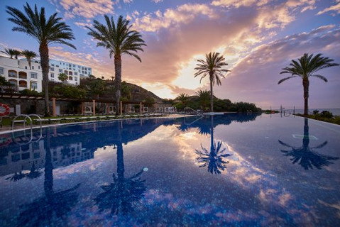 relax by the Playitas hotel infinity pool