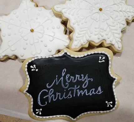 Merry Christmas and snowflke decorated sugar cookies