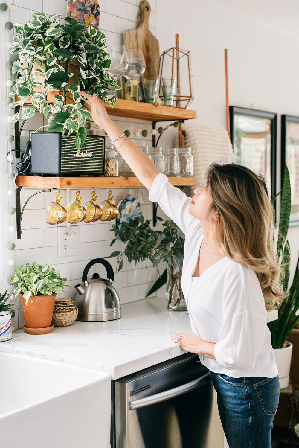 Janet Kwan captured this picture of me fondly fondling my plants. It looks staged because it is, but I actually go around touching every plant regularly to check their status.