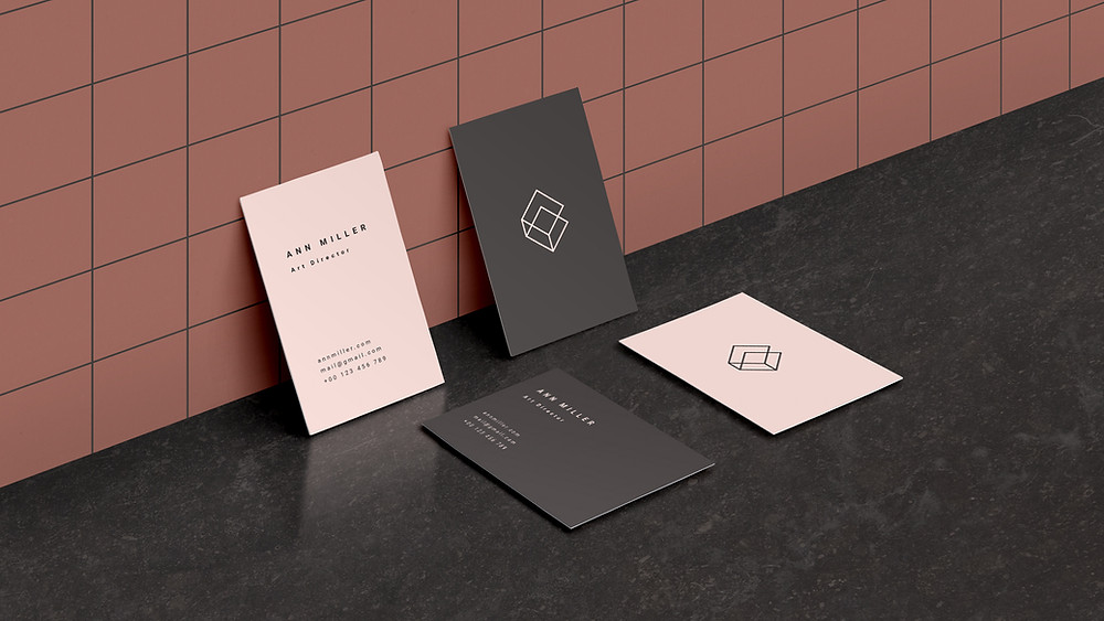 Business cards show a professional brand image.