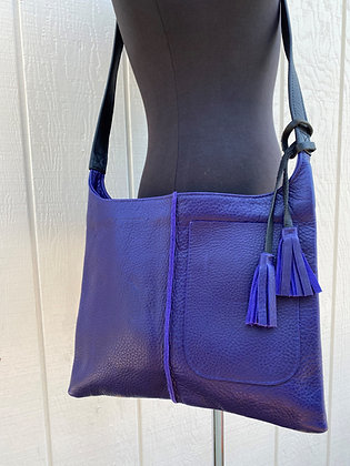 Crossbody, Purple leather with black strap and Exterior pocket (zipper)