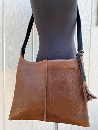 Crossbody, Brown leather with black strap and Exterior pocket (zipper)