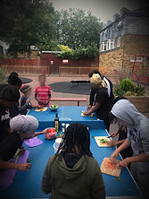young people cooking outdoors