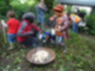 Fathers and children making fire cooking outdoors
