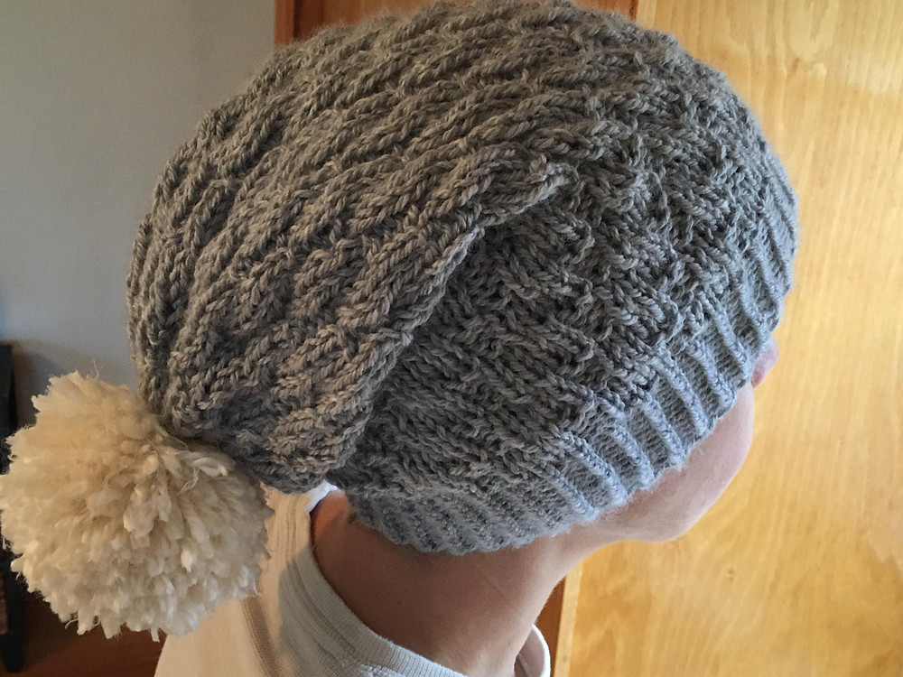 Tester Finished Hat in Gray with handmade yarn pom pom