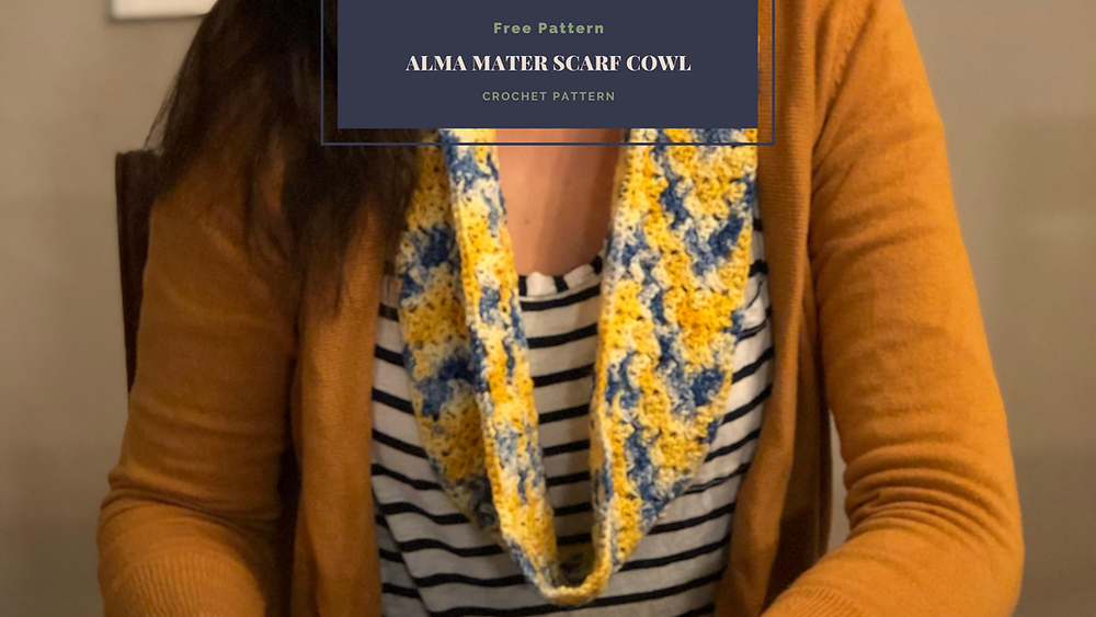 Mustard sweater over a White and Navy Striped shirt with a chevron style blue, gold and white scarf