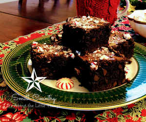 pyramid og large square brownies with broken peppermint pieces on a green and gold plate