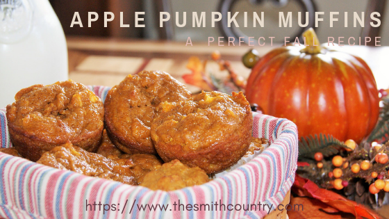Small apple pumpkin muffins in a color lined basket next to a fake pumpkin.