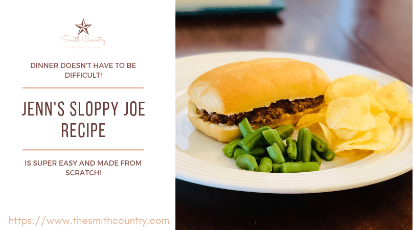 A sloppy joe on a long hard roll, green beans and potato chips on a white plate.