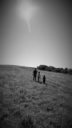 My husband, Nathan Smith, and my 2 oldest children walking up a hill in Cross Plains, WI.