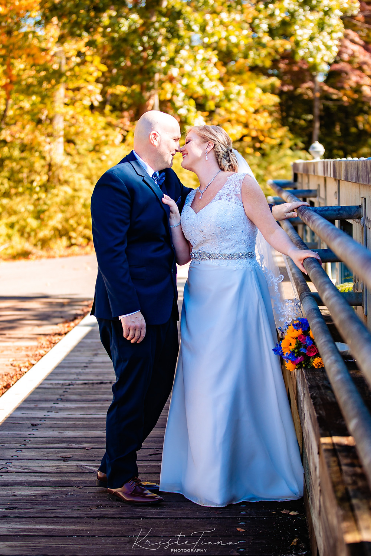 newlyweds kiss bridge