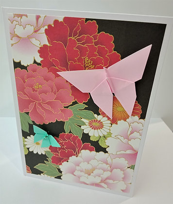 Pink and aqua butterflies on floral background