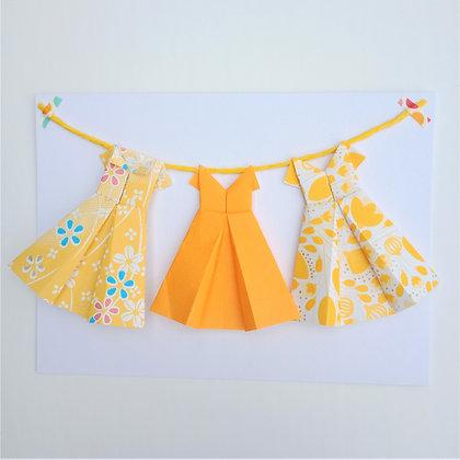 Three little dresses on a line - yellow theme
