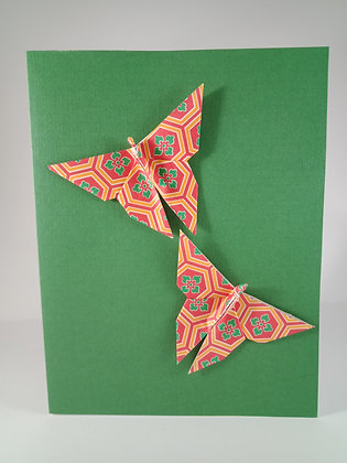 Christmas Card - red, green, orange geometric butterfly on green card
