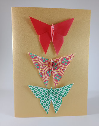 Christmas Card - red, green theme of 3 geometric butterflies on gold card