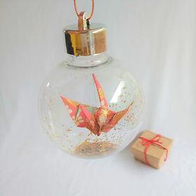 Christmas bauble.  Paper crane (pink ori