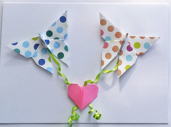 Two butterflies linked with a loveheart